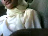 Muslim Scool girl in a car